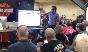 Tim McKeever, marketing manager at Gowanda Harley-Davidson in New York, points out Facebook features to customers during the dealership's Facebook 101 session.