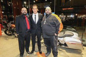 General manager/parts John Maguire, president/general manager Asaf Jacobi and service manager Jim Maguire welcome guests to Harley-Davidson of New York City's grand opening in Tribeca.