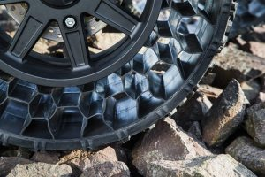 The polymetric web of the Polaris non-pneumatic tire is designed to crawl easily over rocks without punctures destroying it.