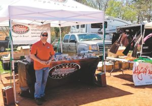 Jason Blake was part of a two-man crew at the Millennium Technologies tent, with the company exhibiting for the first time at Mud Nationals.