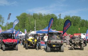 Ray's Sport & Cycle of Grand Rapids, Minn., used large flags affixed to its units to draw attention to its dealership at Quadna Mud Nationals in Hill City, Minn.