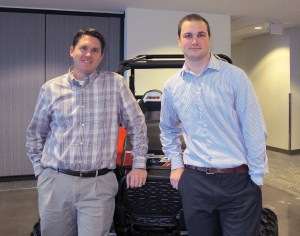Extended warranty manager Tony Poll, left, and marketing analyst Chris Splan are among the team that brought Polaris' extended service contract administration in house.