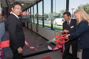 (From left) Terry Okawa, president of Yamaha Motor Corp., U.S.A., Toshi Kato, director, Yamaha Motor Corp. and Kim Ruiz, president and CEO of Yamaha Motor Finance Corp., U.S.A., were stars at the ribbon-cutting ceremony in Cypress, Calif.