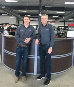 Brewer Cycles owner Chris Brewer (right) and his son Tyler Brewer, VP of the dealership, at their dealership in Henderson, N.C. The Duke Children's Hospital Charity ride began 18 years ago in gratitude after Tyler received care fighting childhood cancer.