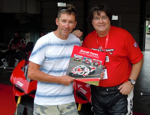 "3-Time Ducati World Superbike Champion Troy Bayliss with Jim Gianatsis and the book ""Ducati Corse World Superbikes"""