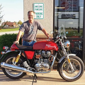 "Dealership owner Tim Woodsome figures out ""what it is"" about motorcyclists by reflecting on some of the folks he's encountered on his journeys."