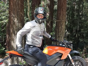 Gart Sutton aboard a Zero motorcycle in the Redwoods of California.