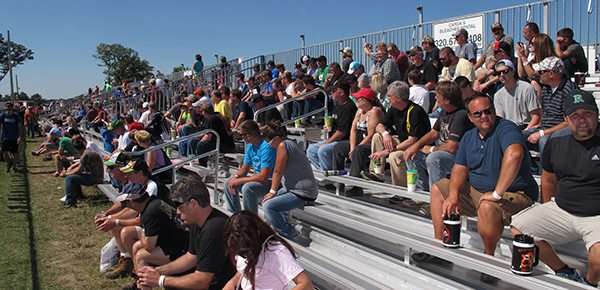 Haydays attendees watch the Grass Drags at the 2014 event in North Branch, Minn. Photo by John Prusak, Snow Goer