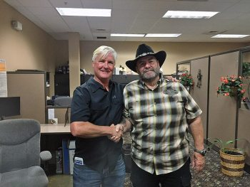 """""""Bert King (left) has taken over ownership of Black Widow Harley-Davidson in Port Charlotte, Fla., from former owner Armand Pinard."""