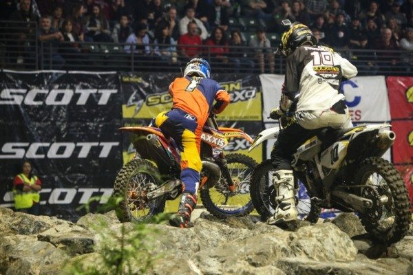 Webb (1) and Haaker (10) fight for their balance and the lead in the difficult rock section in Everett. Photo: Drew Ruiz