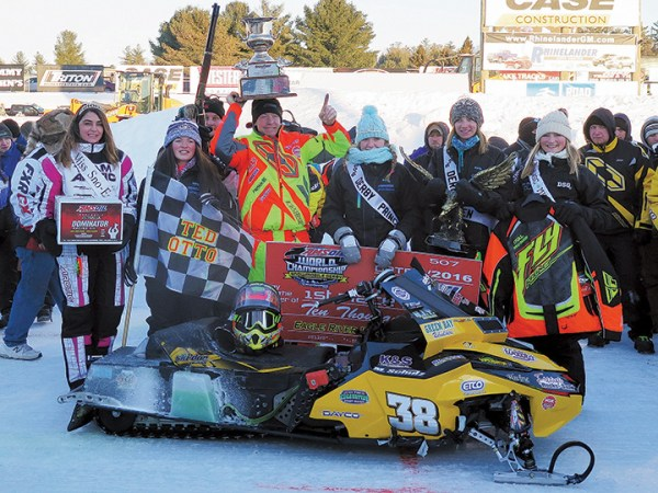 Matt Schulz hoists the coveted Snow Goer Cup after winning his second Eagle River World Championship in Wisconsin.
