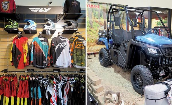 Left: Brands including FLY Racing get premium showcase attention. Right: The store's side-by-side display is one of the best we have seen.