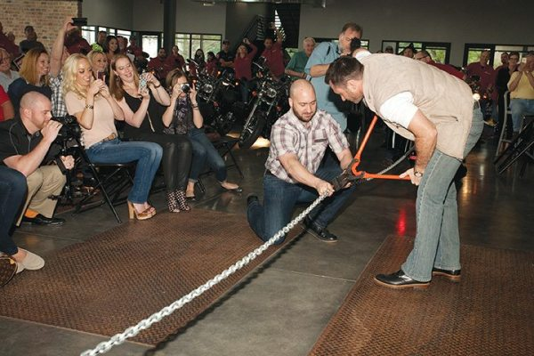 Due to poor weather, a chain cutting took place indoors in place of a traditional ribbon cutting.