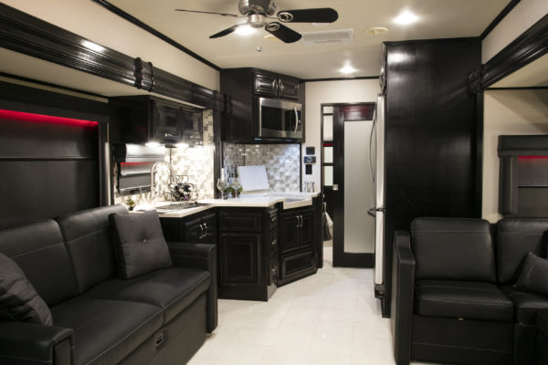 The Status Haulmark Motorcoach features a new floorplan and continued luxury with its custom design selections.