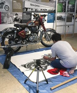 Artist Makoto Endo live paints the Royal Enfield Classic Chrome during the grand opening event.