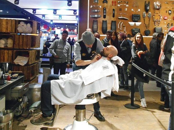 Moto Guzzi fans could shop for bikes, and get a quick shave, in the Moto Guzzi booth.