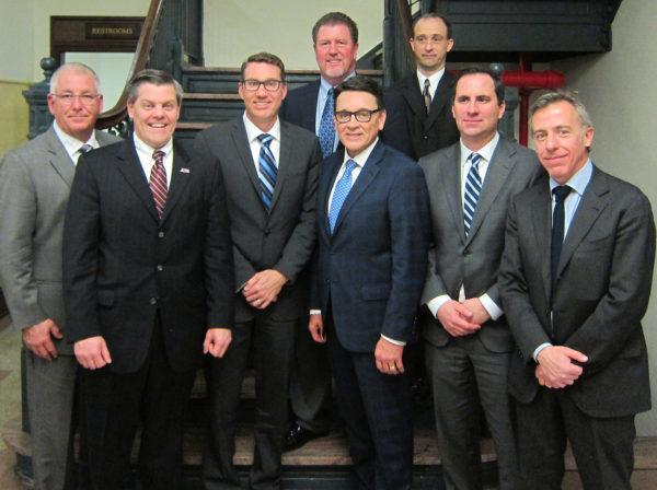 "Front, left to right: Tim Cotter, Rob Dingman, John Hinz, Tim Buche, Iain R. McPhie, Mario Di Maria Back, left to right: Rick Alcon, Carroll ""C.R."" Gittere"