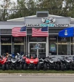 dealership wins fight with city over flying military flags
