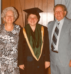 Patti on Graduation Day with her parents