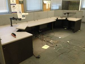 The Pepperell Communications Center, manned continuously since 1988, sat vacant while a state mobile 911 trailer had to be brought in. Everything had to be stripped from this room for mold remediation.