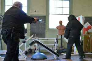 Officer Bezanson asks Lieutenant Blain nicely to keep his distance.