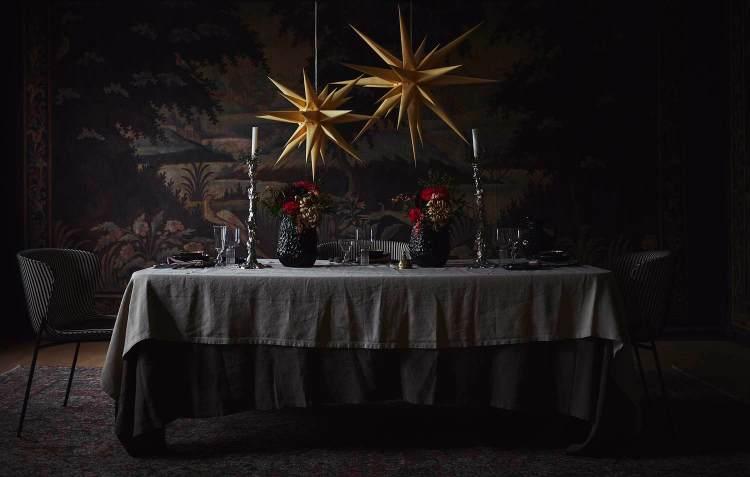simple, minimalist scandinavian christmas ideas: use candlesticks and simple floral arrangements in lieu of a centerpiece