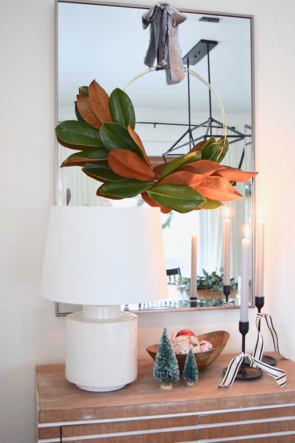 Minimalist Holiday Wreath DIY Project: Modern Gold Hoop Wreath With Asymmetrical Magnola Leaves Hanging by a Velvet Bow