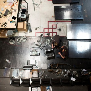 Graduate students work on electrical wiring for an art exhibit piece at the Wells-Metz Theatre on Thursday, Jan. 8, 2015. The piece will be part of the 2015 Prague Quadrennial of Performance Design and Space in June.