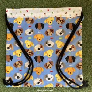 mochila cuerdas perros huellas tela algodon artesanal delante