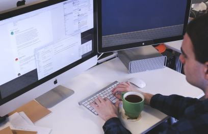 Office worker sat at computer
