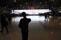 A student releases his glider in the Wings Over the Rockies Air and Space Museum.