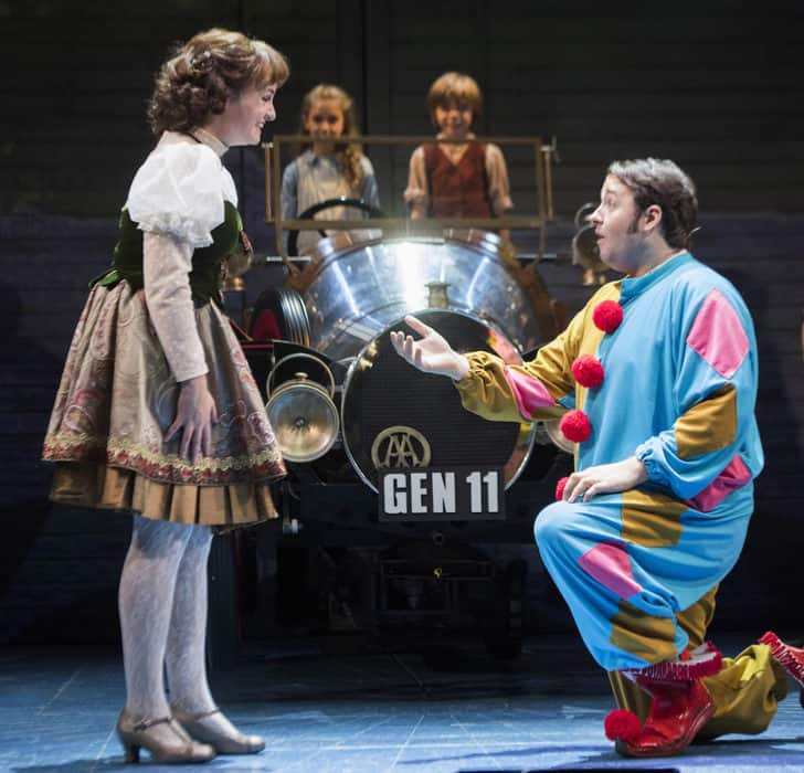 Jason Manford as Caracatus Potts and Charlotte Wakefield as Truly Scrumptious driving Chitty Chitty Bang Bang