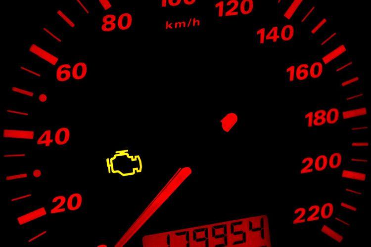 37035768 - check engine light. car dashboard in closeup