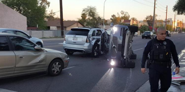 A self-driven Volvo SUV owned and operated by Uber Technologies Inc. is flipped on its side after a collision in Tempe, Arizona, U.S. on March 24, 2017. Courtesy FRESCO NEWS/Mark Beach/Handout