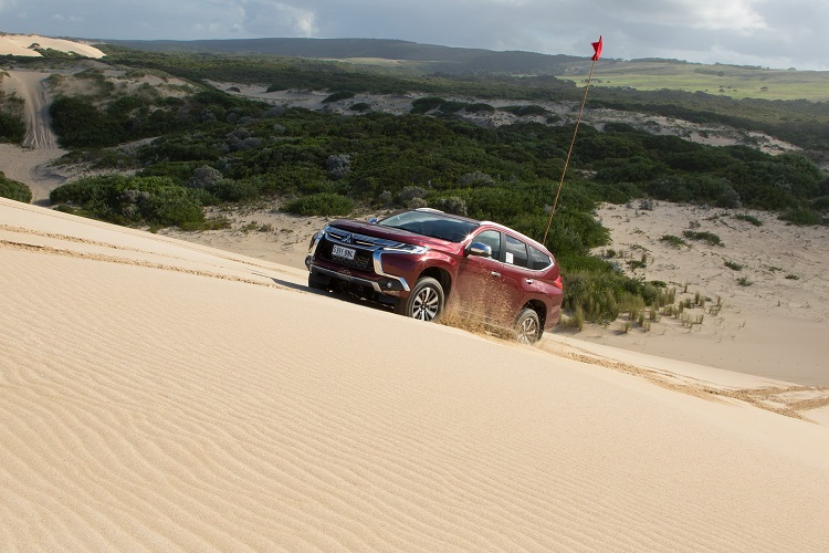 Powering up a hill and kicking up plenty of sand in the Mitsubishi Pajero. Photo by Robert Pepper / Practical Motoring.