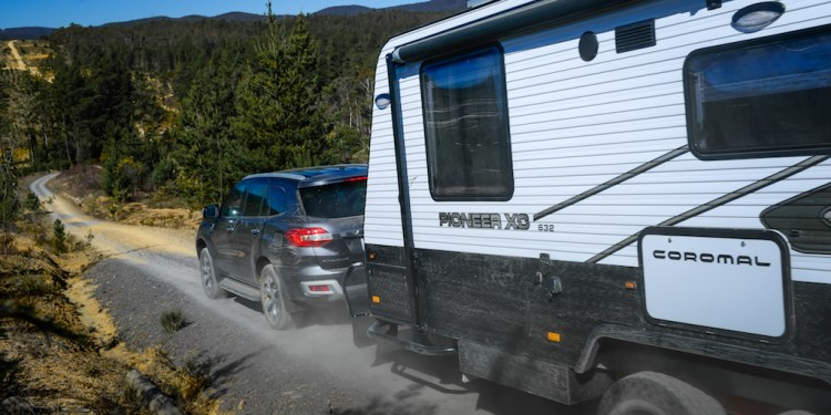 Ford Everest towing a caravan down a rough road