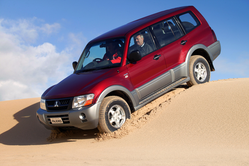 When descending sand dunes, accelerate over the crest then rely on the engine braking to maintain an appropriate speed.
