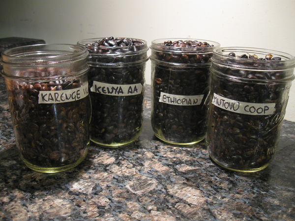 Four batches of home roasted coffee beans, each with a different country or origin. Off-gassing overnight on the counter.