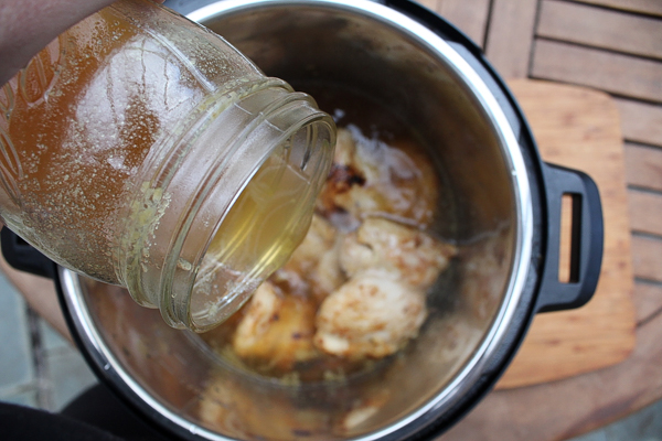 Adding Stock to Chicken Thighs