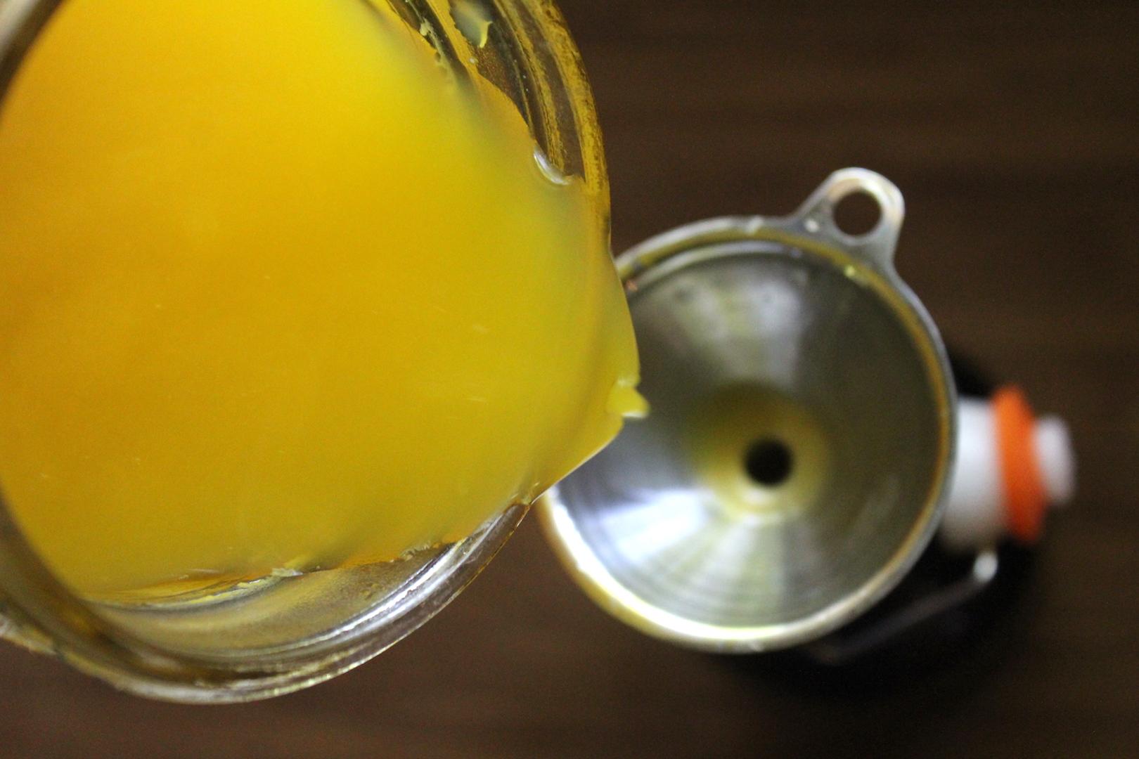 Bottling homemade mango wine