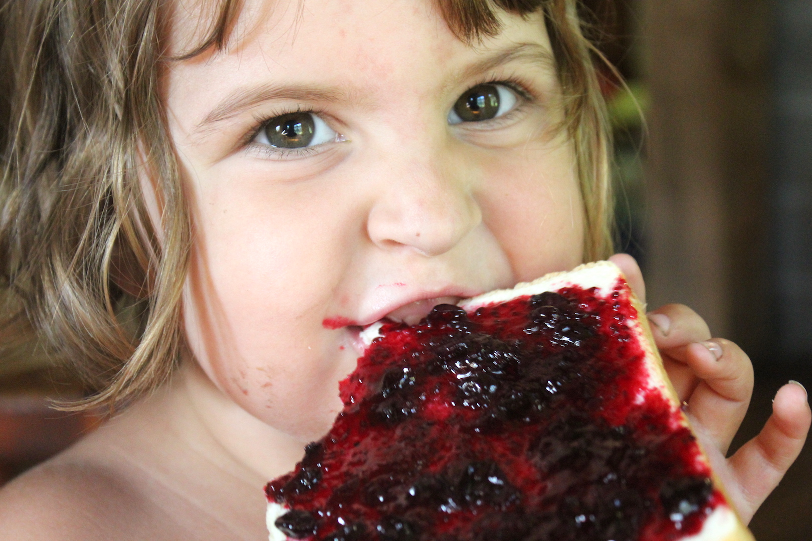 Child Eating homemade Blackcurrant Jam
