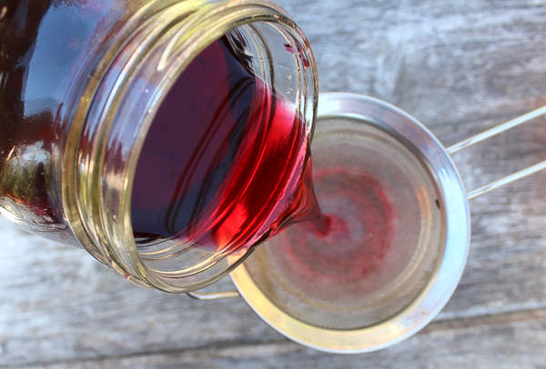 Filtering Homemade Blackcurrant Liqueur (Cassis)
