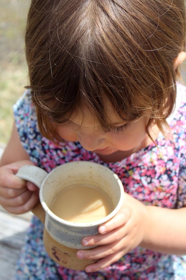 Child Drinking dandelion coffee