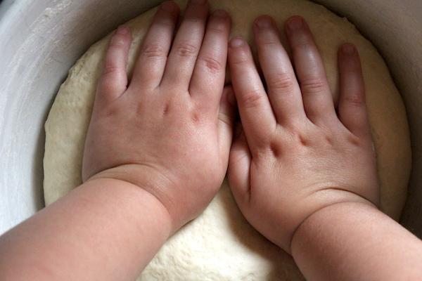 Child Kneading Amish White Bread