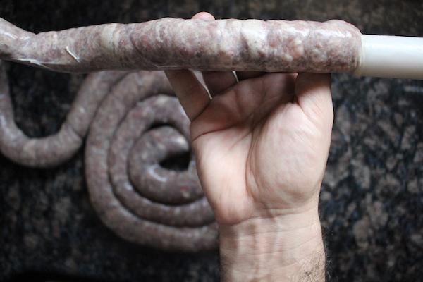 Stuffing lamb sausage into casings