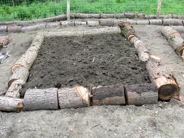 Homemade Log Raised Beds