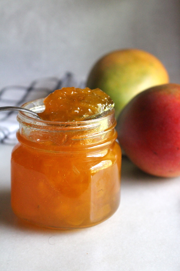 Homemade Mango Jam ~ This simple mango jam recipe is an easy way to preserve mangoes at home with just a few ingredients. All you need is a bit of chopped mango, sugar, citrus and patience. No pectin required!