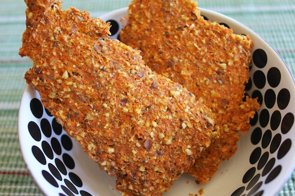 Carrot Juice pulp crackers made using leftover carrot pulp on a silicone mat in a food dehydrator