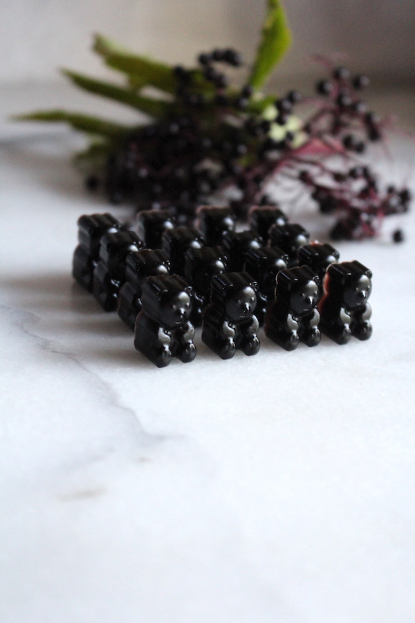 Elderberry gummy bears made from elderberry syrup, including raw honey.