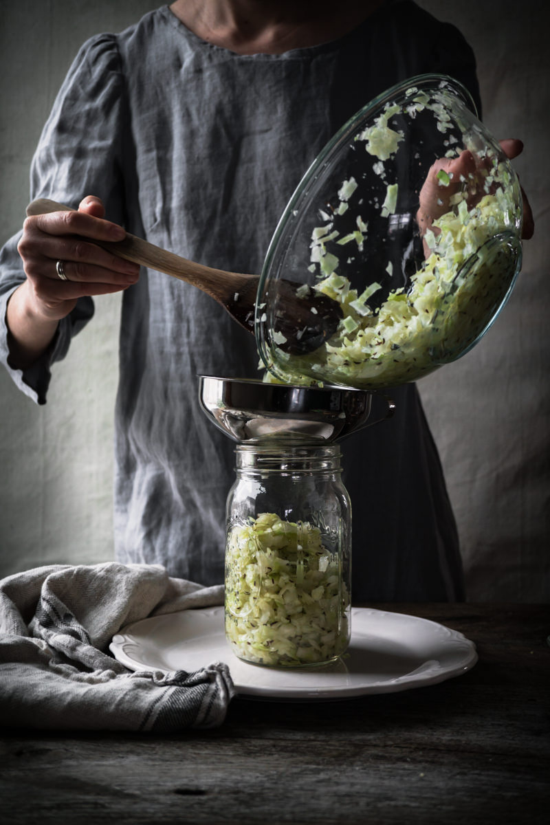 Adding Cabbage to Sauerkraut Fermentation Vessel